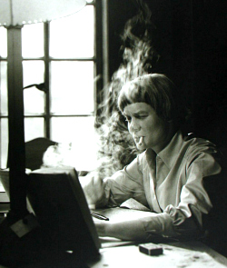 Iris Murdoch writing at her Oxford home in 1958