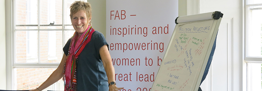 Image of Pauline Harrison, Co-Founder of FAB and Programme Leader of WSLA standing in front of a FAB banner during WSLA 2016