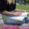 Student reading in the park