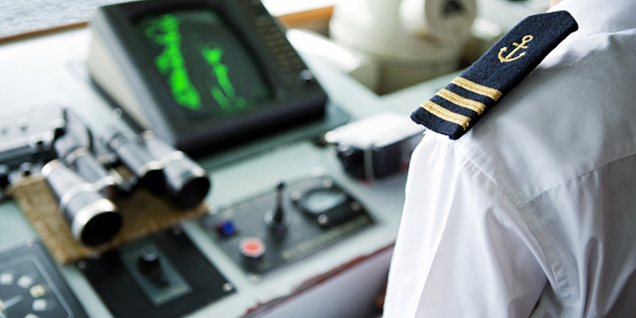 Captain-at-ships-helm