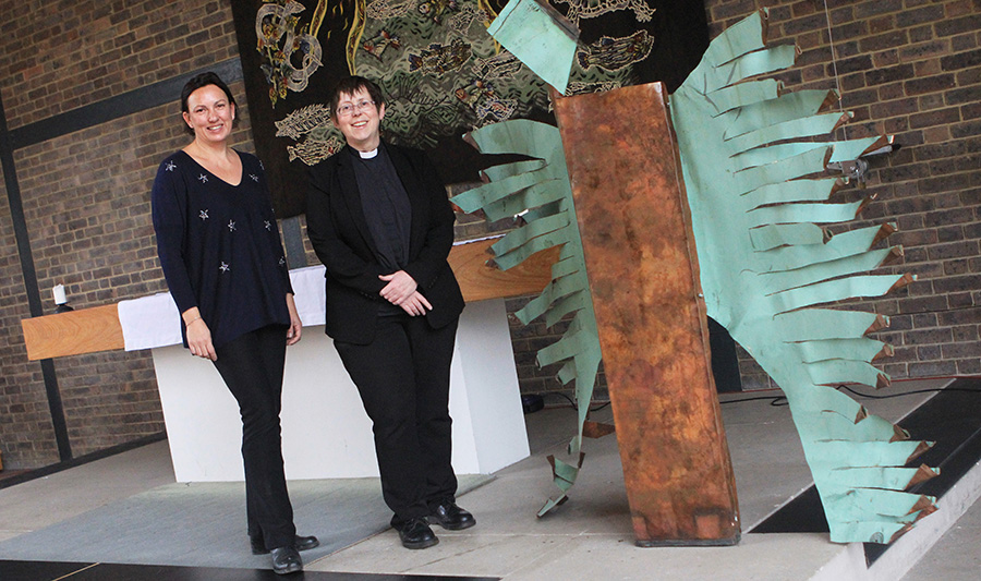 Student Helen Solly and University Chaplain Rev Dr Alison Green next to the angel sculpture