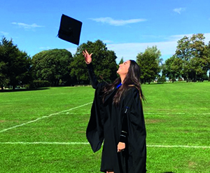 Holly throwing graduation cap in the air
