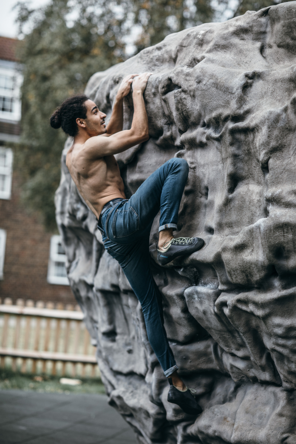 Man on outdoor climbing boulder