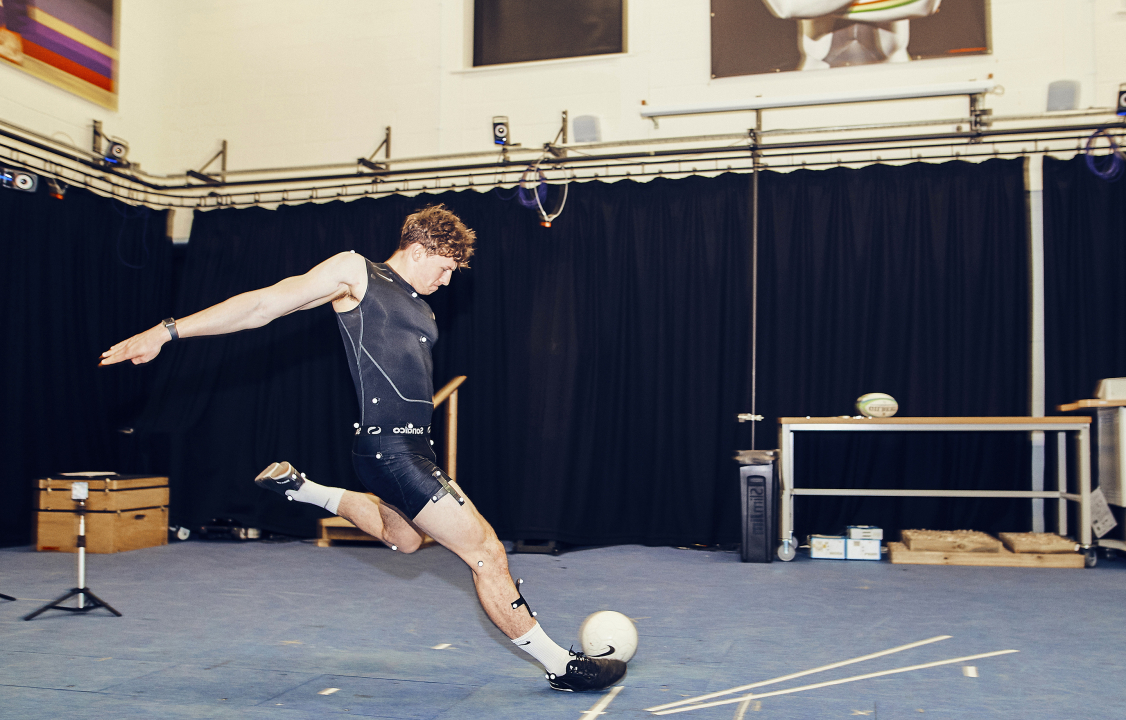 Student kicking football for biomechanical testing